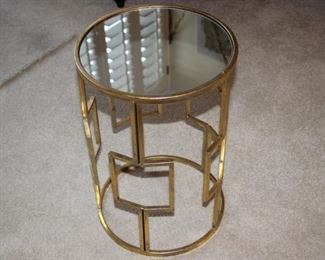Glass and brass end table.