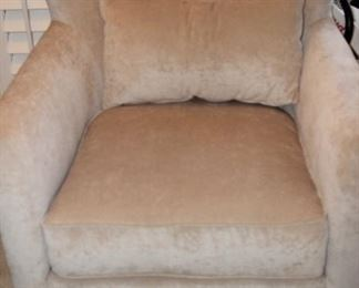 Beige colored arm chair with hobnails.
