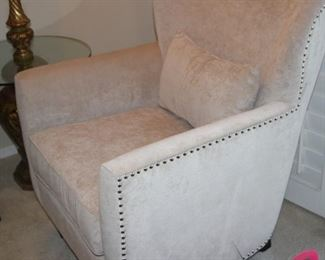 Beige armchair with hobnail trim.