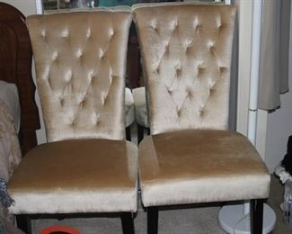 Pair of rose gold colored bedroom/dining chairs.