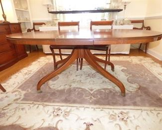 Vintage Mahogany dining table with graceful legs