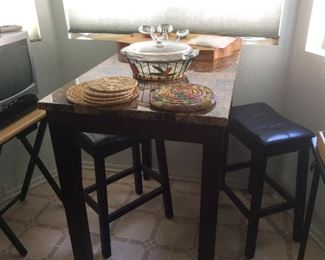 Granite topped table with two stools