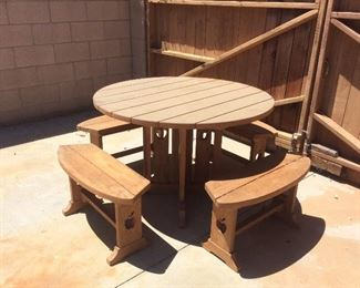 Round wood outdoor picnic table