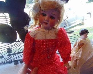 Antique porcelain German doll.  Better photos to come.  Hinged at leg and arm joints.