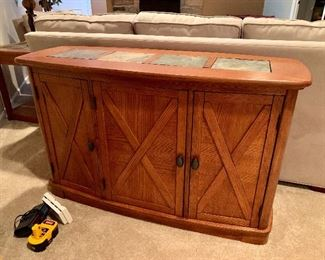 Very nice piece of furniture.  Can be used as a buffet, Foyer/ Sofa Table or a Bar