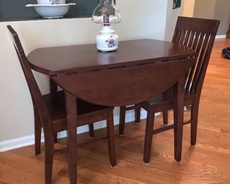 Kitchen table with two fold/drop leaf sides and two chairs. Perfect for those small kitchens or Dining Rooms