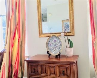 Antique furniture with vintage dish.