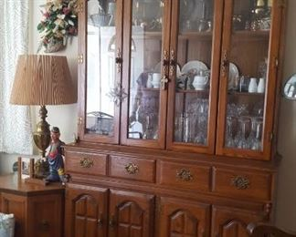 Illuminated China Hutch has TONS of storage in the drawers and cabinets below.