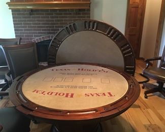 "Beautiful 54"" Braddock Poker Game Table, distressed cherry color, with 6 pleather chairs that rock, swivel, and even have adjustable height!! Table has pull out storage drawers for coasters, cards, etc., and base has storage as well. Complete set at NFM was $2500.00 Our price is a real bargain! Asking $800 OBO Features Lightly distressed finish in Hampton Cherry on select hardwoods and veneers This pub and amp game table has durable clear coat for wear protection Accommodates 6 people and features six full-extension drawers. Each drawer holds beverages and snacks and includes a removable sandstone drink coaster to absorb moisture The reversible removable top features rare olive ash burl veneers on the dining surface side and a fabric poker-playing surface on the other The storage base features four framed panels with rare olive ash burl veneers which complement the tabletop A hinged door offers access to convenient storage in the base for accessories. Storage area includes a fixed shel"