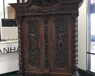 An impressive antique Italian armoire wardrobe carved to superior standards and in extremely well kept condition. Purchased from a NY gallery and placed in a Tower Grove North home. Knockdown precision makes it surprisingly easy to move.
