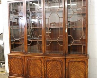 Large attributed to Baker Furniture Individual Pane 4 Door 2 Piece Burl Mahogany China Cabinet  Auction Estimate $700-$1500 – Located Inside