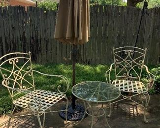 3 outdoor chairs, glass top table and umbrella