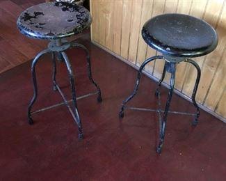 2 swivel metal stools