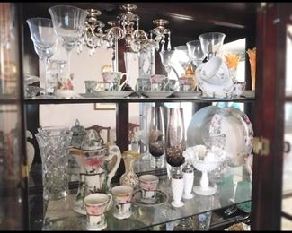 China Cabinet with Pottery and Glass Collectibles.