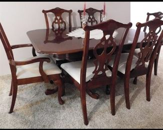 Dining Room Table with six chairs and two leafs.
