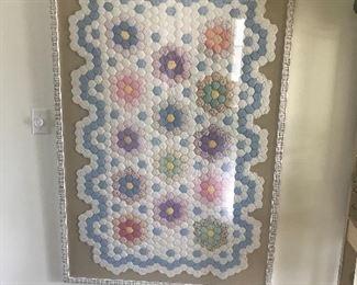 Vintage quilt beautifully framed