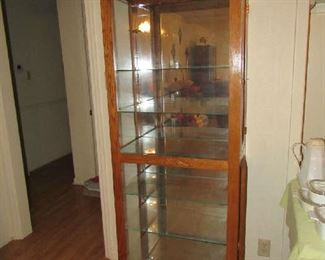 One of two matching curio cabinets