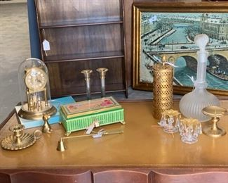 lot of items, including clock, glass bottle, green box
