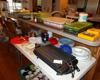 lots of cookware, barstools