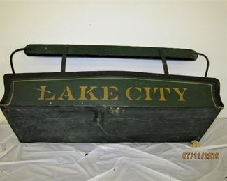 antique LAKE CITY Buckboard seat with original green paint.