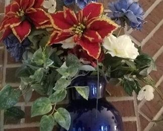 BLUE VASE OF ARTIFICIAL FLOWERS