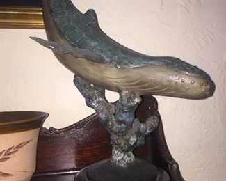 Signed whale statue