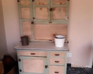 "Seller's Brand Hoosier cabinet with slag glass panels along the top of the doors. The piece measures 42"" wide x 68"" tall x 27"" deep."