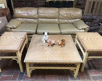 Vintage 1980s butterscotch leather couch, chair and ottoman by Classic Leather Co. Vintage wicker/rattan coffee table and two end tables by Henry Link.