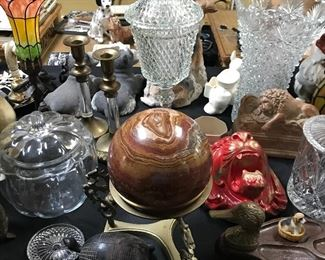 Tables loaded with all kinds of decor, lamps, figurines and more.