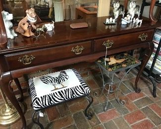 Two mahogany console tables, footstool and plant stand.