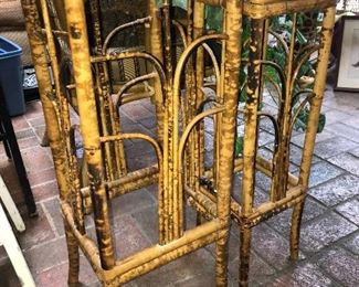 Two Asian-style bamboo plant stands.