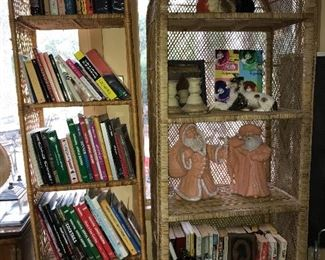Two wicker/rattan shelves with books and decor.