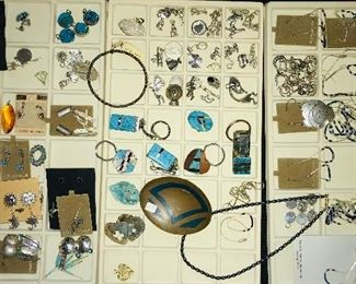 Lots of sterling silver pieces, many with Southwestern themes.