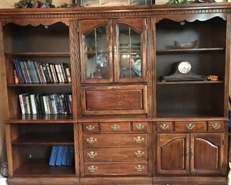 3-piece wall unit features bookshelves, fold-down writing desk, drawer, glass doors cabinet and solid doors cabinet.