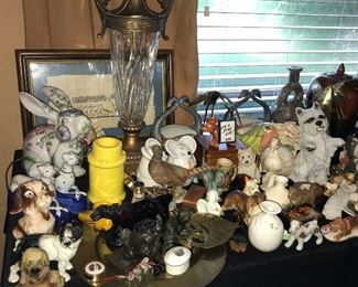 Early photos of tables loaded with all kinds of decor, lamps, figurines and more.