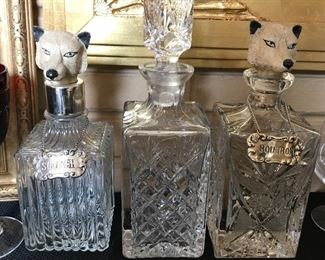 Assorted crystal decanters.