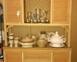 """Assorted pieces """"Traditional Wicker"""" furniture by Henry Link—tables, buffet, lighted china hutch and more."""
