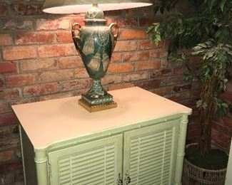 One of several pale green vintage furniture pieces by Henry Link furniture.