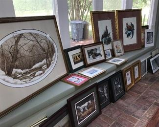 Many framed prints, assorted themes.