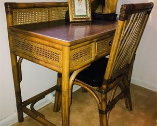 Vintage rattan and wicker desk and chair.