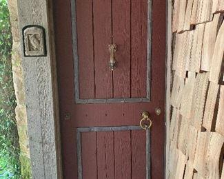 Cedar Entry Door features lead detailing and antique hardware