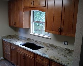 Updated kitchen, granite tops, lots of cabinet storage and drawers, pull out trash can