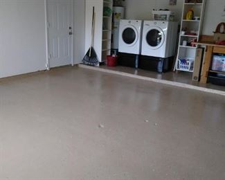 Epoxy painted garage floor with two work benches. Washer dryer and fridge to stay with ful price offer.
