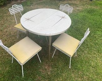 Umanoff outdoor chairs and 50's starburst table