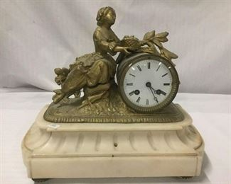 Lot 151 - Antique figural brass clock with marble base - porcelain face and Victorian woman motif