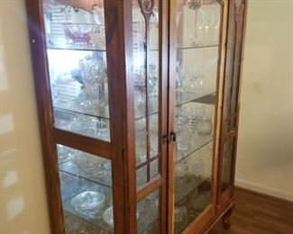 gorgeous lighted glass on three sides hand made cabinet
