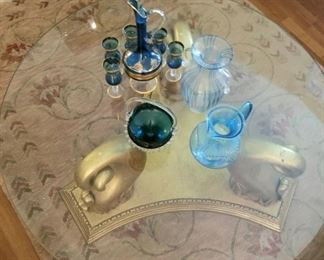 Glass top coffee table with gold pedestal base