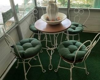 Small wrought iron parlor table and chairs sold