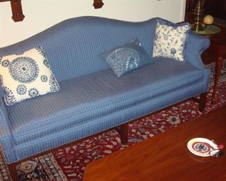 Custom upholstered camel back Chippendale style sofa