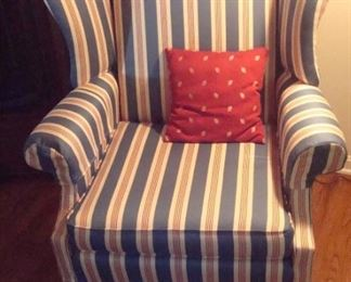 One of a pair custom upholstered wing back chairs.